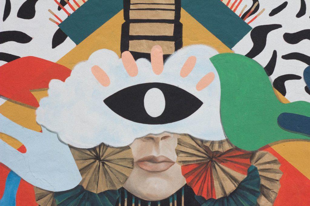 Abstract schilderij met centraal een zwart oog